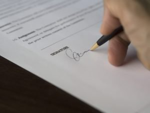 charleston wv divorce attorney signing a document